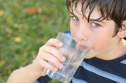 shot of a boy drinking a glass of water