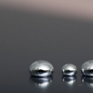 Shiny Mercury drops on a pit black background